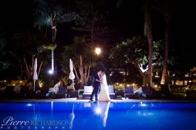 Bride and groom poolside