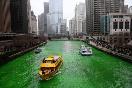 """The dyeing of the Chicago River began at about 10 a.m. as thousands """"ooohed"""" in the frigid temperatures as a boat left a trail of lime green dye in the water in downtown Chicago on March 16, 2013. (Brian Cassella, Chicago Tribune)....OUTSIDE TRIBUNE CO.- NO MAGS, NO SALES, NO INTERNET, NO TV, CHICAGO OUT, NO DIGITAL MANIPULATION...B582783487Z.1"""