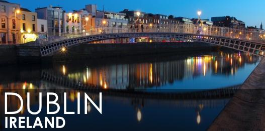 Dublin night scene with Ha'penny bridge and Liffey river lights . Ireland