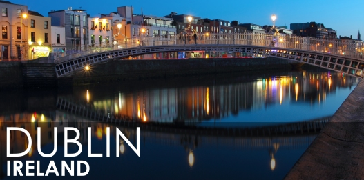 Dublin night scene with Ha'penny bridge and Liffey river lights . Ireland