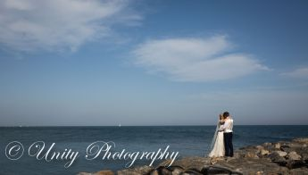 Bride and groom by the rocks