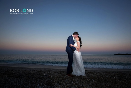 Bride and groom on the beach at Sunset
