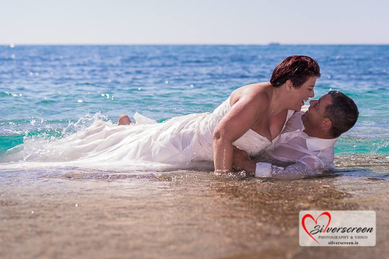 Wedding dress trash shoot in the sea