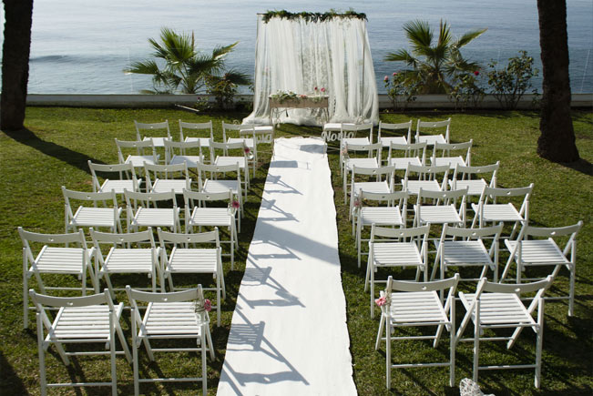 Blessing ceremony by the sea with white carpet